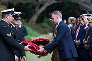 Representatives of the British Embassy in japan lay wreaths of poppies during the  Remembrance Sunday ceremony at the Hodogaya, Commonwealth War Graves Cemetery in Hodogaya, Yokohama, Kanagawa, Japan. Sunday November 11th 2018. The Hodagaya Cemetery holds the remains of more than 1500 servicemen and women, from the Commonwealth but also from Holland and the United States, who died as prisoners of war or during the Allied occupation of Japan. Each year officials from the British and Commonwealth embassies, the British Legion and the British Chamber of Commerce honour the dead at a ceremony in this beautiful cemetery. The year 2018 marks the centenary of the end of the First World War in 1918.