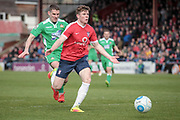 Alex Whittle (York City) sees the ball back to his keeper during the Vanarama National League match between York City and Wrexham FC at Bootham Crescent, York, England on 17 April 2017. Photo by Mark P Doherty.
