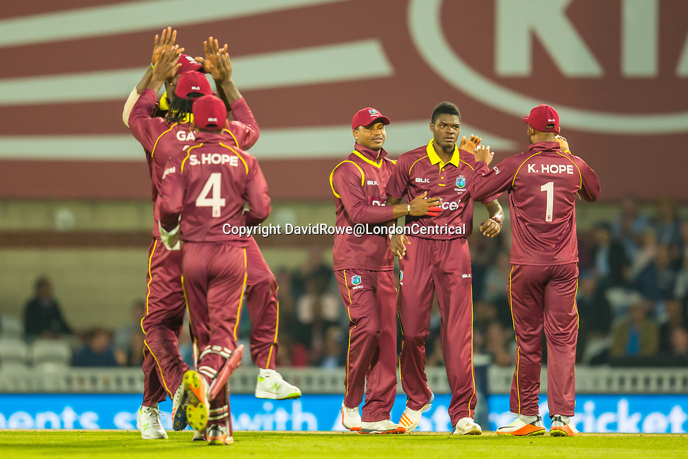 London,UK. 27 September 2017. Alzarri Joseph is congratulated by team mates  after getting his fifth wicket of the innings. England v West Indies. In the fourth Royal London One Day International at the Kia Oval.