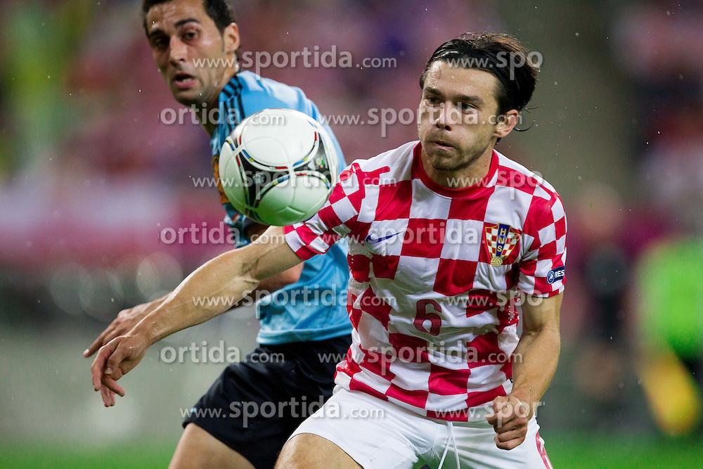 Álvaro Arbeloa of Spain vs Danijel Pranjic  of Croatia during the UEFA EURO 2012 group C match between  Croatia and Spain at PGE Arena Gdansk on June 18, 2012 in Gdansk / Danzig, Poland. (Photo by Vid Ponikvar / Sportida.com)