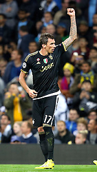 Mario Mandzukic of Juventus celebrates after scoring the equalising goal to make it 1-1 during the UEFA Champions League group stage match between Manchester City and Juventus at the Etihad Stadium - Mandatory byline: Matt McNulty/JMP - 07966386802 - 15/09/2015 - FOOTBALL - Etihad Stadium -Manchester,England - Manchester City v Juventus - UEFA Champions League - Group D