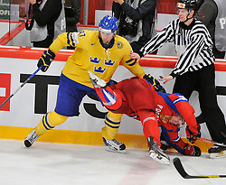 11.05.2012, Ericsson Globe, Stockholm, SWE, IIHF, Eishockey WM, Russland (RUS) vs Schweden (SWE), im Bild, Sverige Sweden 11 Daniel Alfredsson Russia 37 Alexander Perezhogin (Avangard Omsk) // during the IIHF Icehockey World Championship Game between Russia (RUS) and Sweden (SWE) at the Ericsson Globe, Stockholm, Sweden on 2012/05/11. EXPA Pictures © 2012, PhotoCredit: EXPA/ PicAgency Skycam/ Simone Syversson..***** ATTENTION - OUT OF SWE *****