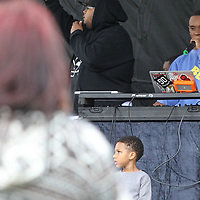 "Slim Jxmmi, with the rap group Rae Sremmurd, works the DJ booth as he entertains the crownd at a ""Put the guns down"" gun violence awareness block party at Gumtree Park in Tupelo on Sunday."