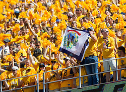 Sep 3, 2016; Morgantown, WV, USA; West Virginia Mountaineers students cheer from the stands during the first quarter against the Missouri Tigers at Milan Puskar Stadium. Mandatory Credit: Ben Queen-USA TODAY Sports