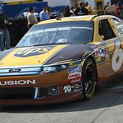 Sprint Cup Series driver David Ragan (6) drives the UPS Ford through the garage area at the Daytona International Speedway on February 18, 2011 in Daytona Beach, Florida. (AP Photo/Alex Menendez)