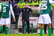 Neil Lennon, head coach of Hibernian FC gesticulates to his defence during the Ladbrokes Scottish Premiership match between Hibernian and Rangers at Easter Road, Edinburgh, Scotland on 19 December 2018.
