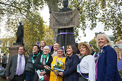 London, UK. 5 November, 2019. MPs (l-r) Gerald Jones, Tonia Antoniazzi, Madeleine Moon, Chris Ruane, Carolyn Harris, Jo Stevens and Ruth Jones join campaigners from WASPI (Women Against State Pension Inequality) protesting in Parliament Square to call for fair transitional pension arrangements for women born in the 1950s affected by the changes to the State Pension Age (SPA), including a 'bridging' pension to provide an income from age 60 until State Pension Age and recompense for losses incurred by women who have already reached their SPA.