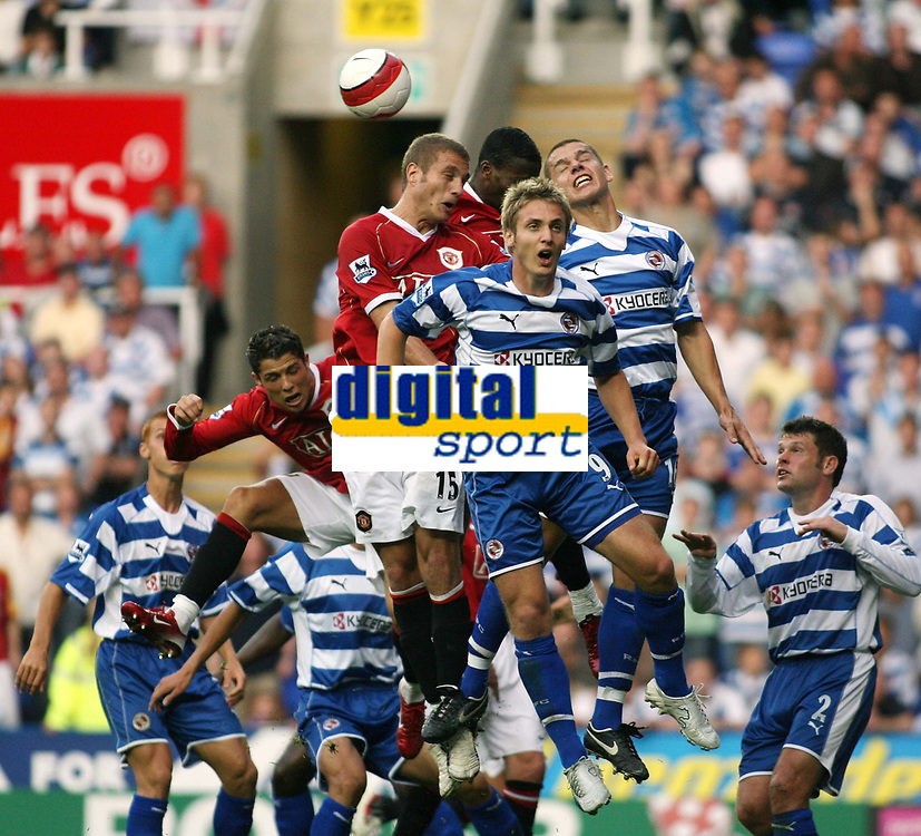 Photo: Chris Ratcliffe.<br />Reading v Manchester United. The Barclays Premiership. 23/09/2006.<br />Kevin Doyle, Ivar Ingimarsson (far left) of Reading clash with Nemanja Vidic (far right) Louis Saha of Man Utd.