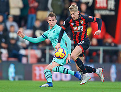 BOURNEMOUTH, ENGLAND - Sunday, November 25, 2018: AFC Bournemouth's David Brooks (L) and Arsenal's Rob Holding during the FA Premier League match between AFC Bournemouth and Arsenal FC at the Vitality Stadium. (Pic by David Rawcliffe/Propaganda)