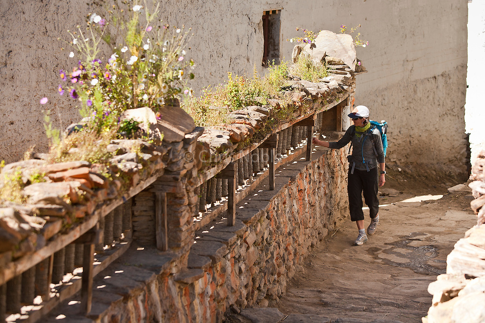 Amy Hahn spinning prayer wheels in a village in Nepal's Mustang Region.
