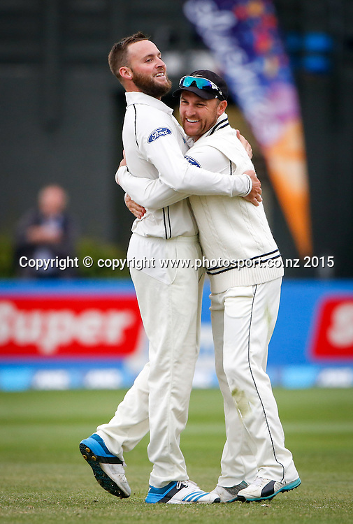 Brendon McCullum congratulates Mark Craig on taking a wicket. Fourth day, second test, ANZ Cricket Test series, New Zealand Black Caps v Sri Lanka, 06 January 2015, Basin Reserve, Wellington, New Zealand. Photo: John Cowpland / www.photosport.co.nz