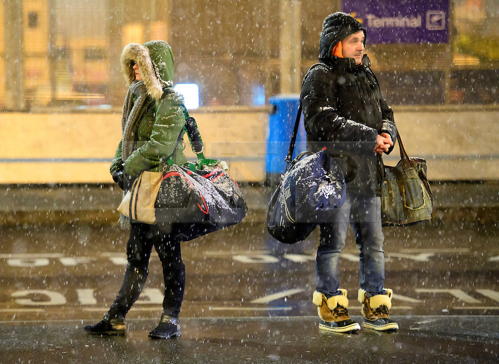 """© Licensed to London News Pictures. 12/01/2017. Luton, UK. Heavy snowfall at Luton Airport in Bedfordshire for the first time this winter, on January 12, 2017. Weather warnings are in place across the UK as a """"polar maritime airmass"""" from northern Canada spreads across the country, bringing snow, ice, rain and freezing temperatures. Photo credit: Ben Cawthra/LNP"""