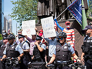 Members of the Chicago Police Department form a human barricade to protect anti-Sharia law demonstrators