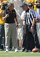 September 29 2012: Iowa Hawkeyes head coach Kirk Ferentz talks with an official during the first quarter of the NCAA football game between the Minnesota Golden Gophers and the Iowa Hawkeyes at Kinnick Stadium in Iowa City, Iowa on Saturday September 29, 2012. Iowa defeated Minnesota 31-13 to claim the Floyd of Rosedale Trophy.