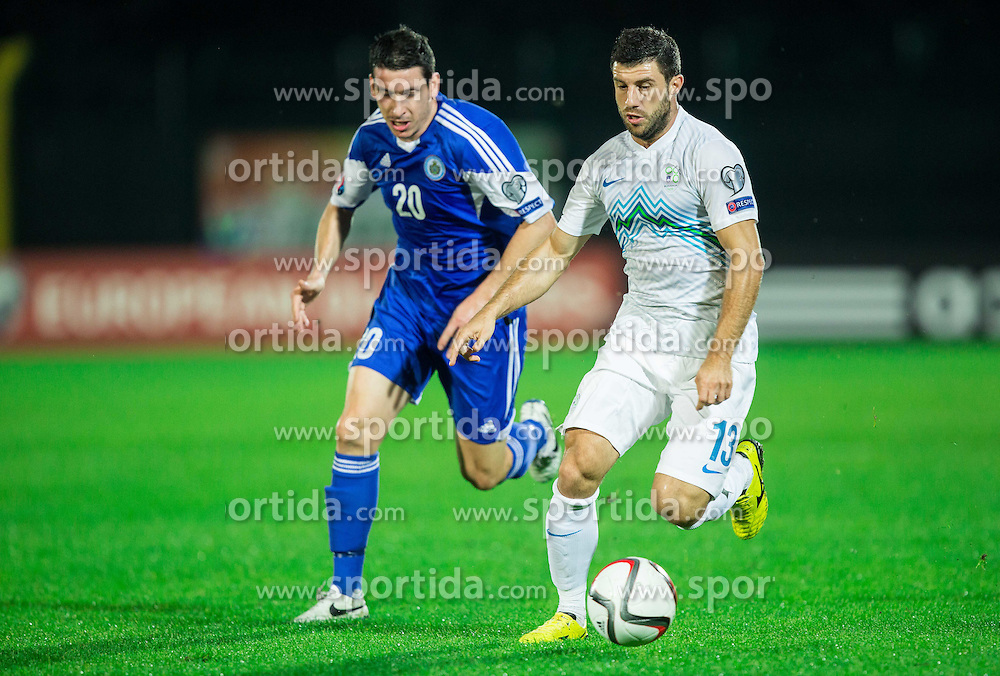 Alex Gasperoni of San Marino vs Bojan Jokic of Slovenia during football match between National teams of San Marino and Slovenia in Group E of EURO 2016 Qualifications, on October 12, 2015 in Stadio Olimpico Serravalle, Republic of San Marino. Photo by Vid Ponikvar / Sportida