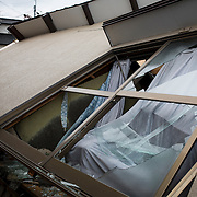 KUMAMOTO, JAPAN - APRIL 22:  A wreck house is seen through the wreckage of houses on April 22, 2016 in Mashiki town, Kumamoto, Japan. To date 48 people are confirmed dead and more than 80,000 people have evacuated after an 6.5 earthquake on Thursday night and a stronger 7.3 quake on Saturday morning struck the Kyushu Island in western Japan.<br /> <br /> Photo: Richard Atrero de Guzman