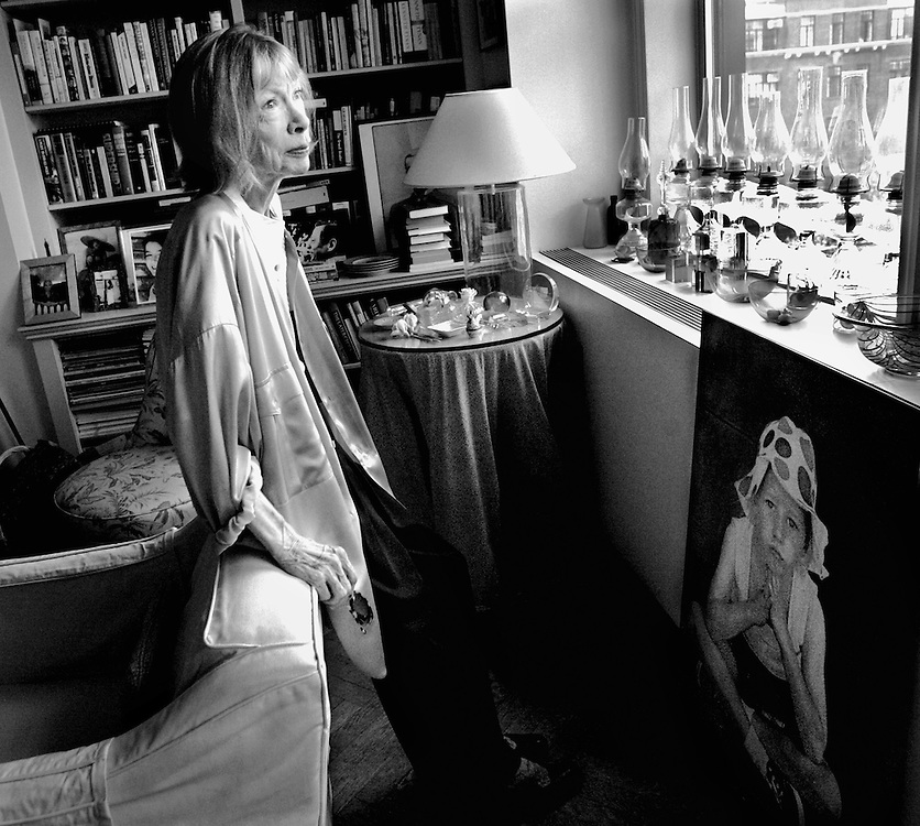 "Author Joan Didion in her New York City apartment with a portrait of her daughter Qunitanna , her only child, who died a few days after this photo was taken. Didion had just written a best-selling memoir "" The Year of Magical Thinking"", based on her personal experiences dealing with grief following the sudden death of her husband, author John Gregory Dunne, the previous year. Qunitanna was in a coma at the time of Dunn's death, and had to be told of his death by Didion when she awoke."