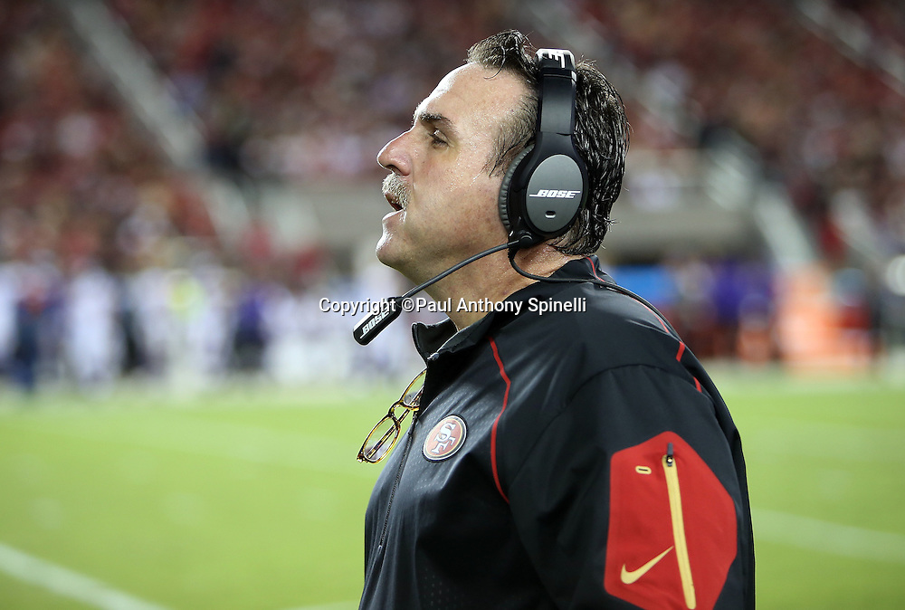 San Francisco 49ers head coach Jim Tomsula looks on from the sideline during the 2015 NFL week 1 regular season football game against the Minnesota Vikings on Monday, Sept. 14, 2015 in Santa Clara, Calif. The 49ers won the game 20-3. (©Paul Anthony Spinelli)