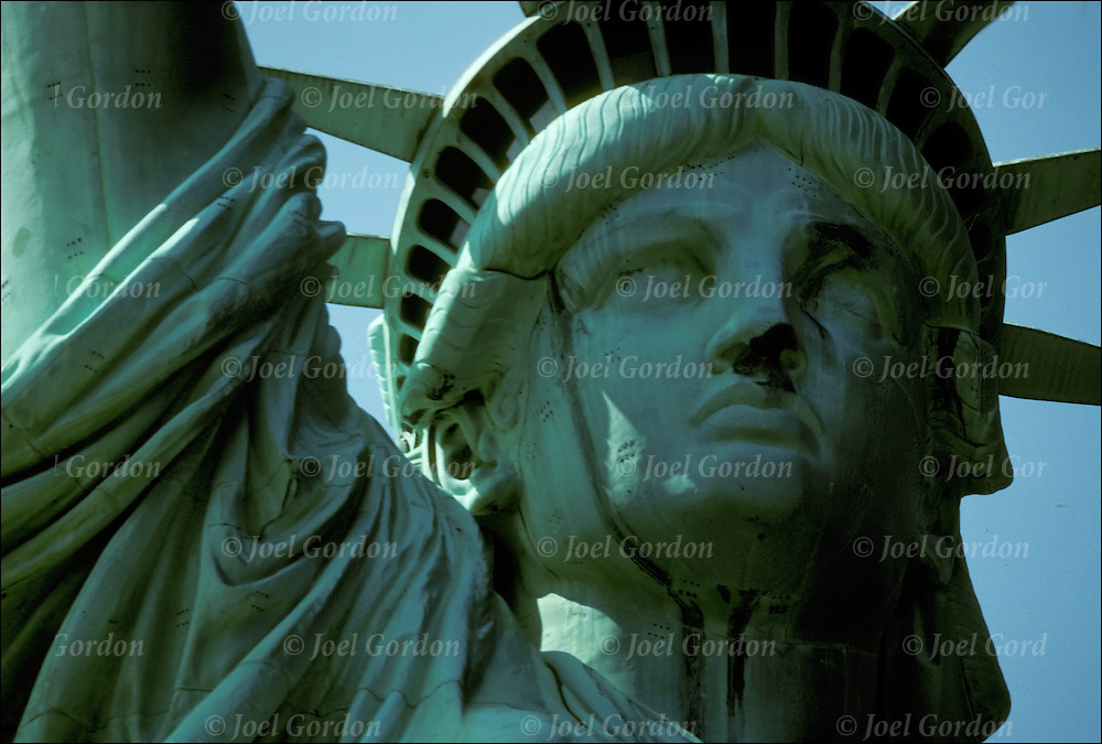 Close up view of the Statue of Liberty prior to restoration, showing the effects of corrosion and slow oxidation on it's  with pitted rust and corroded green copper patina surface.<br /> <br /> This green patina is due to the surface formation of copper hydroxocarbonate and hydroxosulfate compounds.