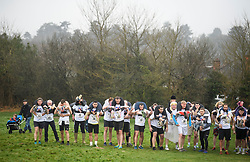 © Licensed to London News Pictures. 08/04/2018. Dorking, UK. Competitors prepare to take part in the 2018 annual Wife Carrying Race in Dorking, Surrey. The race, which is run over a course of 380m, with both men and women carry a 'wife' over obstacles, is believed to have originated in the UK over twelve centuries ago when Viking raiders rampaged into the northeast coast of England carrying off any unwilling local women . Photo credit: Ben Cawthra/LNP