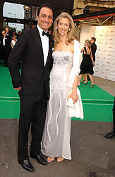 COUNT & COUNTESS ALLESANDRO GUERRINI-MARALDI at the NSPCC's Dream Auction held at The Royal Albert Hall, London on 9th May 2006.<br />