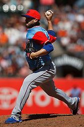 SAN FRANCISCO, CA - AUGUST 26: Cory Gearrin #44 of the Texas Rangers pitches against the San Francisco Giants during the eighth inning at AT&T Park on August 26, 2018 in San Francisco, California. The San Francisco Giants defeated the Texas Rangers 3-1. All players across MLB will wear nicknames on their backs as well as colorful, non-traditional uniforms featuring alternate designs inspired by youth-league uniforms during Players Weekend. (Photo by Jason O. Watson/Getty Images) *** Local Caption *** Cory Gearrin