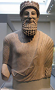 Colossal limestone statue of a bearded man.  Made in Cyprus about 450 BC.  From the sanctuary of Apollo-Reshef in the city - kingdom of Idalion in central Cyprus.  Only the upper part survives, dressed in  Greek fashion, he is typically Cypriot in his hairstyle and beard.