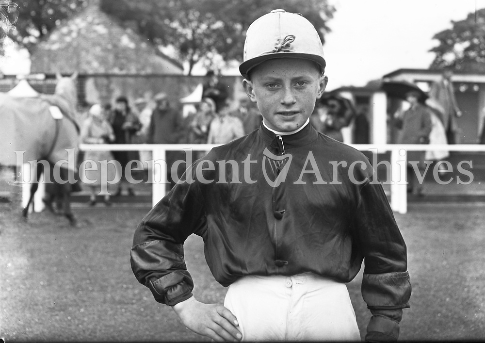 R1594<br /> Apprentice Jockey, P.J. O'Sullivan at the races, location unknown, May 14 1958. <br /> (Part of the Independent Newspapers Ireland/NLI collection.)