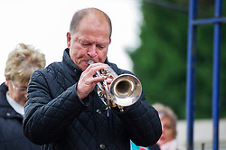 A trumpet is played during the service - Mandatory byline: Dougie Allward/JMP - 07966 386802 - 11/11/2015 - Memorial Stadium - Bristol, England- Memorial Service