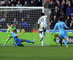 Tottenham Hotspur's Hugo Lloris saves Swansea City's Wilfried Bony's shot - Photo mandatory by-line: Joe Meredith/JMP - Tel: Mobile: 07966 386802 19/01/2014 - SPORT - FOOTBALL - Liberty Stadium - Swansea - Swansea City v Tottenham Hotspur - Barclays Premier League