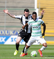 Yeovil Town's Joel Grant is tackled by James Spencer of Notts County Photo mandatory by-line: Harry Trump/JMP - Mobile: 07966 386802 - 11/04/15 - SPORT - FOOTBALL - Sky Bet League One - Yeovil Town v Notts County - Huish Park, Yeovil, England.