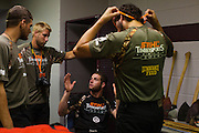 Garret Gregorek (seated) speaks to friends backstage at the Stihl Timbersports Championships at The Norfolk Scope in Norfolk, Virginia on June 20, 2014.