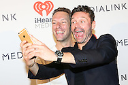 CAP D'ANTIBES, FRANCE - JUNE 21:  Ryan Seacrest doing a selfy with Chris Martin at a dinner party hosted by iHeartmedia and Medialink featuring a special performance by Chris Martin of Coldplay during the Cannes Lions Festival of Creativity at Hotel du Cap-Eden-Rock on June 21, 2016 in Antibes, France.  (Photo by Tony Barson/Getty Images for iHeartMedia)