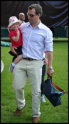 Peter  Phillips at the fairground  with his daughter children Isla  at the Windsor Horse Show. Windsor, United Kingdom. Saturday, 17th May 2014. Picture by Andrew Parsons / i-Images