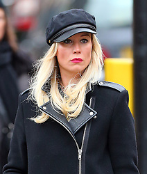 Denise Van Outen wearing a black cap, black coat, black tights and pair of ankle boots out Christmas shopping in London. The actress/presenter has recently been lined up with ITV's daytime programme Loose Women. UK. 18/12/2013<br />BYLINE MUST READ : JAMESY/GOTCHA IMAGES<br /><br />Copyright by © Gotcha Images Ltd. All rights reserved.<br />Usage of this image is conditional upon the acceptance <br />of Gotcha Images Ltd, terms and conditions available at<br />www.gotchaimages.com