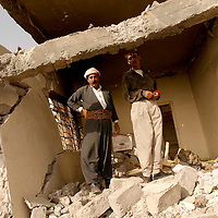 SHEKHAN (Ayn Sifni), NORTHERN IRAQ - April 9: Two Kurds are standing in the rubble of a house in  Shekhan. A town of about 30000 inhabitants on the way to Mossul has been taken by Peshmergas. Kurdish Peshmergas and US Special forces are advancing towards  Mossul.   (Photo Patrick Barth/Getty Images)
