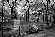 NEW YORK, NY - April 17:  A man sits on a bench in the Mall of Central Park on April 17, 2014 in NEW YORK, NY.  (Photo by Michael Bocchieri/Bocchieri Archive)