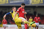 Oxford United Forward, Antonio Martinez (7) beats Swindon Town Defender, Raphael Rossi Branco (29) to the ball during the EFL Sky Bet League 1 match between Swindon Town and Oxford United at the County Ground, Swindon, England on 5 February 2017. Photo by Adam Rivers.