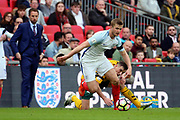 Eric Dier of England battles for possession whilst England Manager Gareth Southgate looks on during the FIFA World Cup Qualifier group stage match between England and Lithuania at Wembley Stadium, London, England on 26 March 2017. Photo by Matthew Redman.