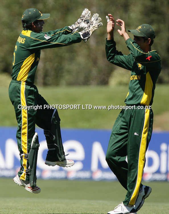 Pakistan Wicketkeeper Mohammad Waqas and Hammad Aziz (right) celebrate running out Jason Floros. Australia v Pakistan, U19 Cricket World Cup Final, Bert Sutcliffe Oval, Lincoln, Christchurch, Saturday 30th January 2010. Photo : PHOTOSPORT
