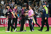 Middlesex win - Eoin Morgan of Middlesex is congratulated by Lewis Gregory of Somerset  during the Vitality T20 Blast South Group match between Somerset County Cricket Club and Middlesex County Cricket Club at the Cooper Associates County Ground, Taunton, United Kingdom on 30 August 2019.