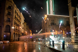 "© Licensed to London News Pictures. 19/01/2020. Beirut, Lebanon. Tear gas and water cannon are used as anti-government demonstrators clash with police in Downtown Beirut, outside the government buildings. The army were later called in to disperse demonstrators. Violence has been escalating in the capital during a ""week of wrath"", where demonstrators have been campaigning against government corruption and economic crisis. Photo credit : Tom Nicholson/LNP"