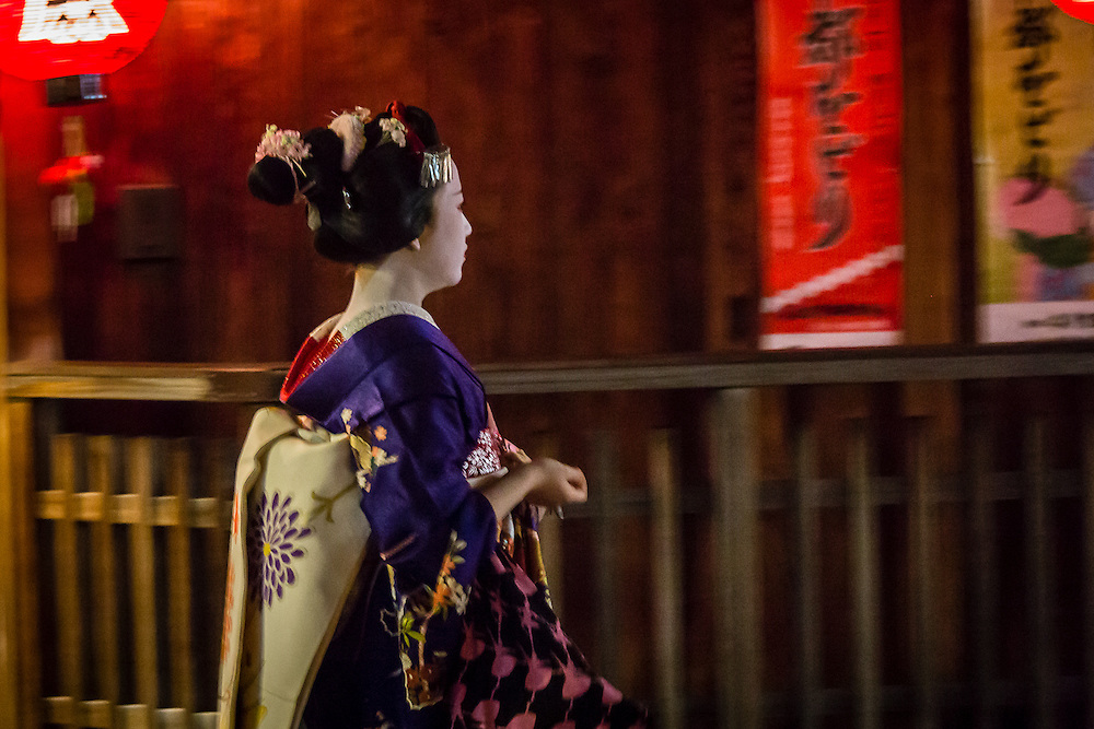 A maiko walks in Hanami Koji, in the district of Gion.
