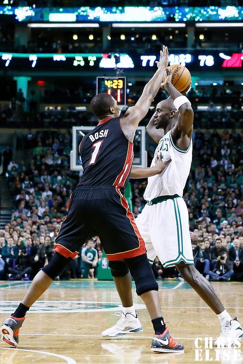 27 January 2013: Miami Heat center Chris Bosh (1) defends on Boston Celtics power forward Kevin Garnett (5) during the Boston Celtics 100-98  2OT victory over the Miami Heat at the TD Garden, Boston, Massachusetts, USA.