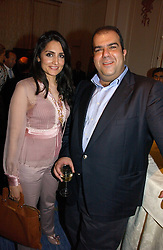 RENU MEHTA and STELIOS HAJI-LOANNOU founder of the Easy group of companies at a party to celebrate the launch of The Business - London's First Global Business Magazine held at the Mandarin Oriental Hyde Park, 66 Knightsbridge, London on 11th October 2006.<br /><br />NON EXCLUSIVE - WORLD RIGHTS
