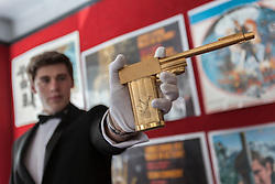 © licensed to London News Pictures. London, UK 28/06/2012. A replica gun from a James Bond classic 'The Man with the Golden Gun' autographed by Roger Moore on the butt of the gun, estimated to be sold for £3000-4000 by Bonhams. Photo credit: Tolga Akmen/LNP