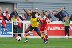 Grace McCarthy of Bristol Academy challenges Arsenal Ladies' Danielle Carter - Photo mandatory by-line: Dougie Allward/JMP - Mobile: 07966 386802 - 20/09/2014 - SPORT - FOOTBALL - Bristol - SGS Wise Campus - BAWFC v Arsenal Ladies - FA Womens Super League