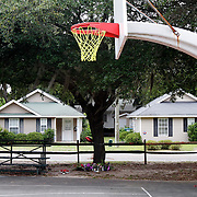 A makeshift memorial is seen below a tree along the basketball courts near the intersection of Greene Street and Hamar Street in Beaufort on May 7, 2015.