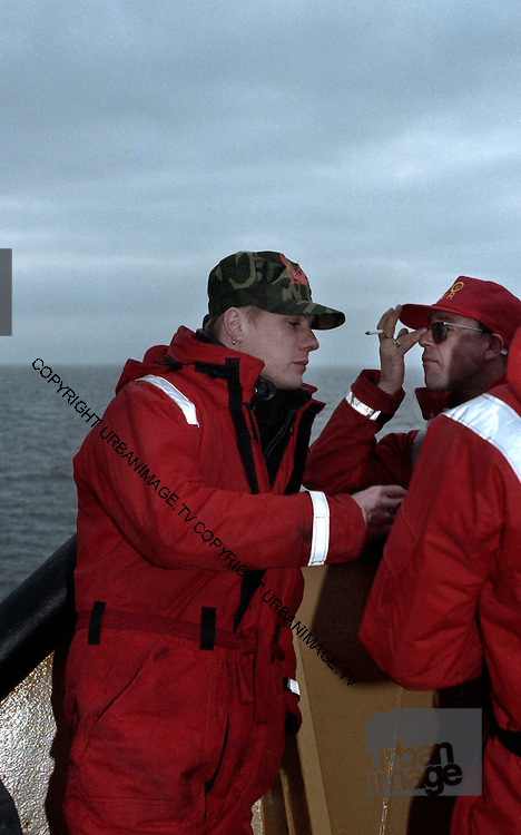 Larry Mullen  photographed on the Rainbow Warrior at a U2 Greenpeace protest at the Sellafield Nuclear Plant in June 1992.