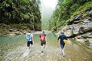 River tracers walking up a river valley near Taroko Gorge.